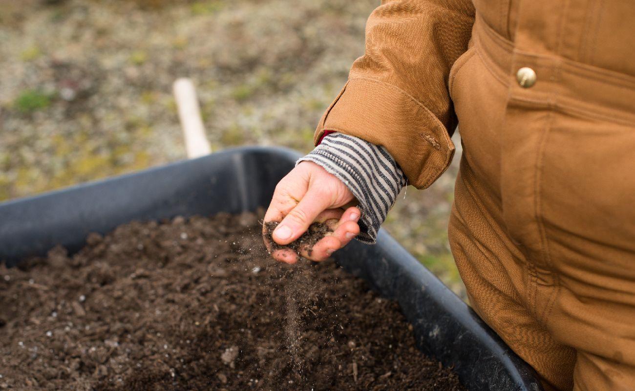 Holding Soil Over Wheelbarrow