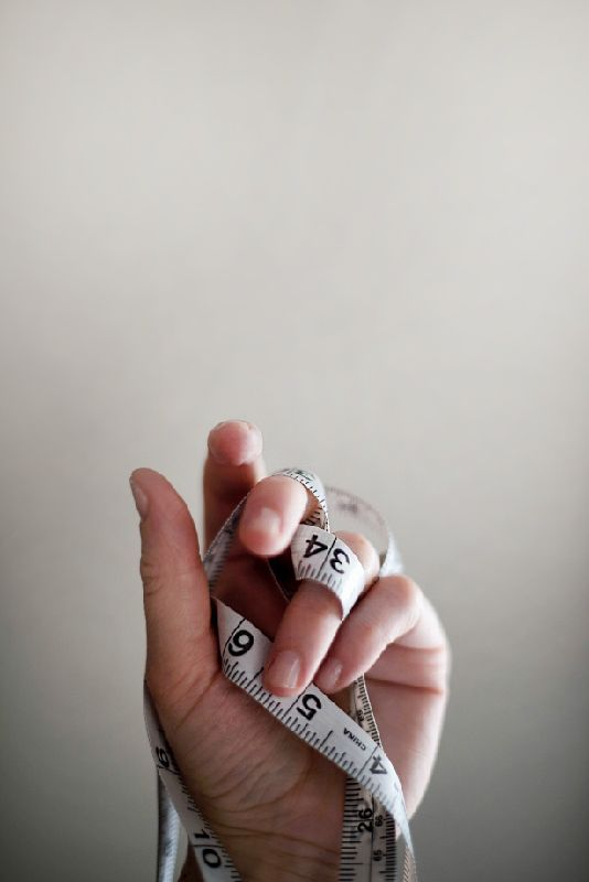Hand Holding Measuring Tape